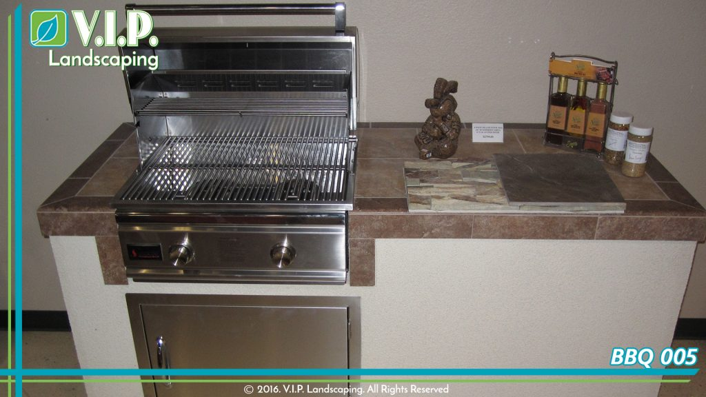 Built-in barbeque. Stainless steel bbq and tile countertop. Simple outdoor kitchen